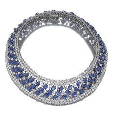 Sapphire and diamond necklace The collar set with brilliant-cut diamonds and cabochon sapphires, mounted in white gold