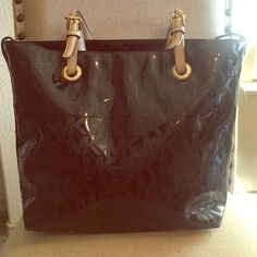 Michael Kors Handbag Black MK handbag. Has 4 pockets and zipper pocket on the inside. The straps are a little worn but in good condition! No trades no holds. 20% off bundles! Michael Kors Bags Totes
