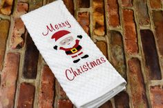 Decorate your Kitchen in style with this Festive Embroidered Merry Christmas Santa Kitchen Towel. The towel is a White cotton basket weave and measures 16 in x 28 in. Great to use and enjoy. Merry Christmas Santa, Christmas Stockings, Etsy Best Sellers, Christmas Kitchen Towels, Holiday Gifts, Holiday Decor, Decorative Towels, Scandinavian Kitchen, Basket Weaving