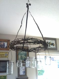 Barbed wire & mason jar chandelier- this would be soooo cute hanging from my big. - Barbed wire & mason jar chandelier- this would be soooo cute hanging from my big pecan tree - Wire Chandelier, Mason Jar Chandelier, Mason Jar Lighting, Barbed Wire Wreath, Barbed Wire Art, Funky Junk Interiors, Western Decor, Country Decor, Western Crafts