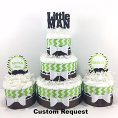 """Large diaper cake centerpiece with the """"Little Man"""" theme. Blue, white, and black are the default colors but you may request your own color scheme. Little Man d"""