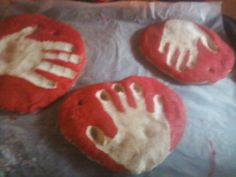 handprint ornaments i made with my babies i babysit! fun project 4 cups of flour 1 cup of salt 1 1/2 cup of water kneed for 15 minutes roll out 1/4 inch thick poke a hole for the ornament bake on 300 for 45 minutes i baked on top of wax paper then flipped them and baked for 30 more minutes next day painted them! i did this with a 2 year old and 4 year old and it kept their attention! had a blast!