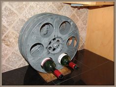 This wine rack shaped like a reel of film. | 23 Gifts Every Movie Lover Will Thoroughly Appreciate