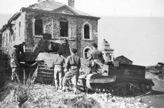 British soldiers inspect abandoned German heavy tank 'Royal Tiger' in La Gleize (La Gleize). British-made armored personnel carrier right Bren Carrier (Bren Carrier).