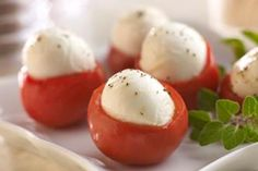 Tomatoes stuffed with mozz. Maybe a leaf of basil, drizzle with olive oil and even balsamic!