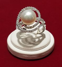 18 kt white gold diamond and 10.75 mm south sea pearl ring.
