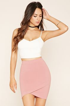 A crinkled stretch-knit skirt featuring a tulip hem and a banded waist. Matching crop top available.