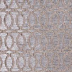 An elegant polyester home fabric featuring texture upon texture: interlocking circles nest atop a striated, woven background. Subtle sheen and satiny feel. This fabric is perfect for bedding, light upholstery, window treatments and accent pieces.