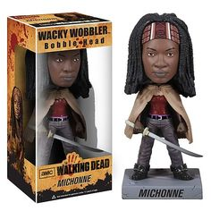 Walking Dead Bobble Head Michonne: Straight out of The Walking Dead hit TV show on AMC comes this amazing wacky wobbler. The Walking Dead Michonne Bobble Head features Michonne, as portrayed by actor Danai Gurira, as a detailed and wobbling bobble head. Measuring 7-inches tall, this is one amazing item for any fan of The Walking Dead series.