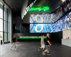 "Videowall | University of Oregon, Football Complex |The 35 ft digital signage system comprised of 64 Planar 55"" LCD display TVs which can play a single broadcast or 64 different programs. CompView.com"