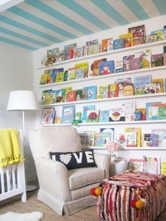 2 smart ideas, 1: paint the ceiling which makes the space feel bigger and 2: storing books along the entire wall giving a colorful accent wall