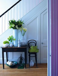 Cabinets under stairs - one door, with nice wall trim to create storage for suitcases, tc.