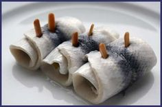 Rollmops -  A roll-mop is a Marinated raw herring with onion and gherkin inside.  Delicious