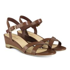 Step into spring in style in the Cole Haan Melrose Low Wedge. These beautiful sandals feature oiled vachetta uppers, full leather lining, a fully padded leather sock lining and a inch heel. Thing 1, Beautiful Sandals, Leather Socks, Low Wedges, Bridesmaid Shoes, Shoe Closet, Fashion Addict, Cole Haan, Wedge Sandals