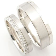 Platinum Matching Pair of Wedding Rings -Designed to compliment each other, a beautiful platinum matching pair of wedding rings.These platinum wedding rings have a shaped inside called a court fit (comfort fit) and a flat top.The ladies ring is set with diamonds all around to one side and a satin finish opposite.The gent's ring is the same shape but slightly wider and a third across has a groove separating the two...