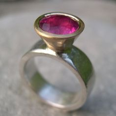 Pink Tourmaline Ring. Set in yellow gold on a silver band. http://www.silverandstone.co.uk/html/designer_rings.html