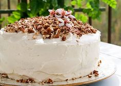 Hummingbird Cake ~ Classic Southern cake made with bananas, pineapple, chopped pecans, and topped with a cream cheese frosting.  And more pecans. ~ SimplyRecipes.com