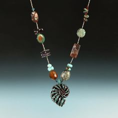 Hand blown art glass nautilus necklace! www.accessoreez.com