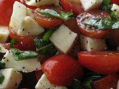 Caprese Salad with Grape Tomatoes, Mozzarella & Basil from La Bella Vita Cucina . a perfect summer salad when tomatoes are at their peak of flavor! Yummy Snacks, Yummy Food, Fun Food, Easy Summer Salads, Rabbit Food, Yummy Eats, Fabulous Foods, International Recipes, Caprese Salad