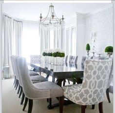 Clean dining room. Love the centerpiece greenery.