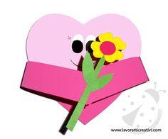 IDEA LAVORETTO CUORE CON FIORE Cuore con fiore Materiale: cartoncini di vari colori forbici colla stick pennarello nero Passaggi:  1 ) Ritagliare un