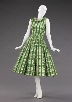 "Rice Bowl Dress | Carolyn Schnurer | c. 1952 For her ""Flight to Japan"" collection, Schnurer adapted elements of Japanese costumes and textiles, as well as architecture and decorative arts. In this example, the neckline, inspired by a reversed kimono, emphasizes the wearer's collar bones and delicately frames the face. The geometric textile pattern is inspired by sekkazome paper (meaning snow flower or snowflake dyeing), a technique in which mulberry paper is accordion pleated, folded into…"