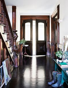 This is very similar to my entryway. The darker wood looks nicer though.