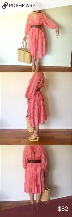 """70s 80s Gauze Dress Tunic Pink Peach Dress M L Beautiful light flouncy, 100% cotton gauze dress.   It's a pull over with a V-neck line, flouncy sleeves with ties at the ends and the back has a tie with jingle bells, making a lovely little tinkle, it's  lined on the inside.  Material: Cotton Gauze  Color/pint: Peachy pink Maker: Amber Origin: Made in India Era: 80's Size: Marked L could fit M-XL     Bust- 40""""  Arm Length- 15"""" Waist- 46"""" Hips- Free up to 60"""" Length- 46""""   Condition: excellent…"""