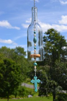 Wine Bottle Wind Chime Turquoise Cross Wind by WhiteRoosterShoppe bottle crafts wind chimes Items similar to Wine Bottle Wind Chime, Turquoise Cross Wind Chime, Recycled Wine Bottle Chime on Etsy Wine Bottle Chimes, Glass Bottle Crafts, Wine Bottle Art, Diy Bottle, Plastic Bottle Tops, Recycled Wine Bottles, Diy Wind Chimes, Wine Craft, Bottle Painting