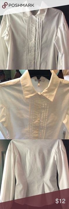 Metro 7 white ladies dress shirt Metro 7 ladies white dress shirt, long sleeved, elastic at bottom of sleeves, pretty detail down front center of blouse, darts to show off breast and figure, puffed sleeves, sIze: small. Excellent condition! Metro 7 Tops Blouses