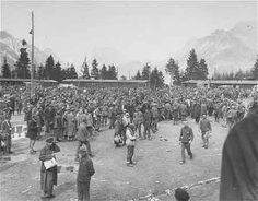 Ebensee Survivors Waiting to Leave  (May 7, 1945)  Survivors congregate in the former roll call area of the Ebensee concentration camp.