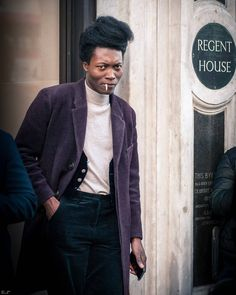 Benjamin Clementine @benjaminclementine on Regent Street back in December 2016. I didn't know who he was at the time. It was his style that caught my attention his hair the rolled cigarette his purple Velvet coat and the glimpse of a vest underneath. He's making headlines this week as the star in the latest @gorillaz video that was released yesterday. I was walking on Regent Street looking for Street Style when I spotted him outside Regent House. His expression is that of someone caught off…