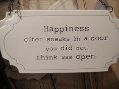 Happiness often sneaks in a door you did not think was open