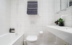 Swedish stylist Lotta Agaton's Stockholm apartment is up for sale , which means we get to see some new pictures from her stylish home, yay! Bathroom Wall Art, Bathroom Signs, White Bathroom, House Doctor, Bathroom Inspiration, Interior Inspiration, Stockholm Apartment, Small Bathtub, Anna
