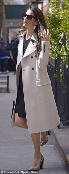 Amal Clooney cuts chic figure in cream coat as she steps out in NYC | Daily Mail Online