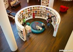 I have seen this in a childrens library and really like the cosy reading nook as well as the shelving space School Library Design, Kids Library, Classroom Design, Room Saver, Library Architecture, Library Furniture, Creative Storage, Pillow Room, Learning Spaces