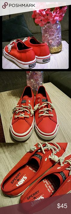 Sperry red sneakers Nwt. Bought at journeys and never wore. Bought for $69.99 + tax. Size 7 women. True red, white leather laces for look. Stretch band inside for fit. Perfect cute red shoes! Pet free smoke free home. Sperry Shoes Sneakers