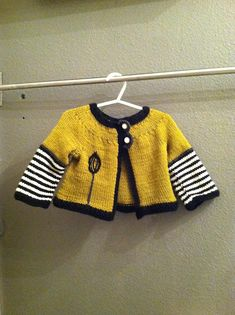 Ravelry: iamleesie's lotta. What an interesting interpretation of the free Green Zebra sweater pattern. Note the black & white stripe on the back just below the neckline. Cute touch!