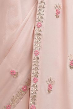 From our Wedding Collection, this is a Nude Pink pure crepe saree and blouse with intricate exquisite rose gold gota patti and floral hand embroidery, embellished with pearl bead highlights. The saree has embroidered borders inches wide and Embroidery On Kurtis, Kurti Embroidery Design, Hand Work Embroidery, Embroidery Flowers Pattern, Couture Embroidery, Embroidery Saree, Hand Embroidery Designs, Gota Patti Saree, Gota Patti Suits
