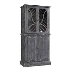 Weathered grey display cabinet with open fret windows and dentil trim  TRANSITIONAL CHINA CABINET IN WEATHERED CORNFLOWER BLUE FINISH  The Wolfe tall accent cabinet gives your home the style and functionality you have been searching for. This cabinet has a dark hand-painted finish with a raised linear pattern on the bottom doors. Four doors open up to generous storage space. Use this cabinet in living room as a curio, in the dining room as a china cabinet, or in any room in your home.