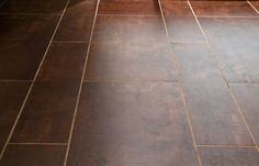 Ceramic tile with worn leather look.