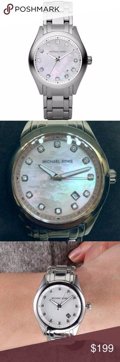 Silver Stainless Mother Of Pearl & Crystal Watch NWT Michael Kors Quartz Silver Stainless Band Mother Of Pearl Dial Women's Watch  Comes Complete with MK Wooden Box & MK Instruction Booklet Style # MK5325 Beautiful Watch! PERFECT for everyday wear Overall look of this watch is exceptional. The Mother of Pearl face shows the color gradients when the light hits it,  and the hands are simple yet very easy to read & the crystals at the hours just add to its attractiveness The Stainless Steel…