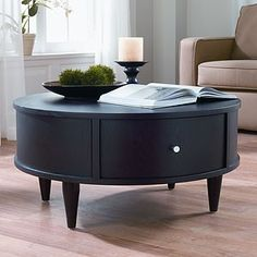 Round coffee table. Really love this! Had to repin it
