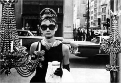 Audrey Hepburn looks stunning in the Givenchy's classic little black dress.