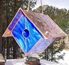 Stained glass and copper birdhouse is functional art for the garden. Birdhouse…