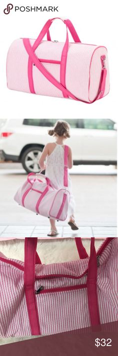 """One left! ❤ Pink Seersucker Duffle Bag 21"""" L x 10"""" W x 14"""" H. Seersucker material. Inside lining. Zipper closure and adjustable/removable shoulder strap. Outside and inside zipper pocket. Reinforced bottom with rubber feet. Easy-to-carry handles. New with tags. WB Bags Travel Bags"""