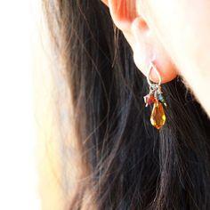 Orange dangle stud earrings in silver wire