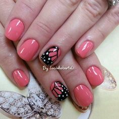 Pink butterfly nail art.