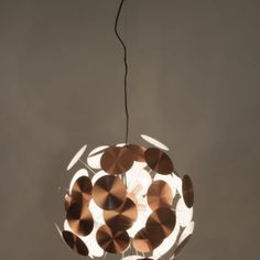 Have your guests flattered by your choice in lighting with the Plenty Work pendant lamp. This striking lamp somewhat resembles a disco ball and gives you a reason to rave and party like never before. Boasting a spherical appearance adorned with different sized pins and discs, both of which look ever so attractive and highly stylish. The gorgeous lamp comes in a white, chrome, and copper appearance, all of which look ever so posh and royal. Trash Bins, Disco Ball, Recycling Bins, Pendant Lamp, Garden Inspiration, Outdoor Lighting, Chrome, Table Lamp, Indoor