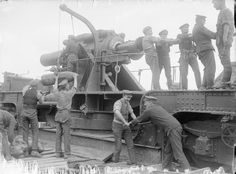 MINISTRY INFORMATION FIRST WORLD WAR OFFICIAL COLLECTION (Q 710)   12-inch howitzer on a railway mounting being prepared for action; 89th Siege Battery, R.G.A., Dickebusch, 14th June 1916.